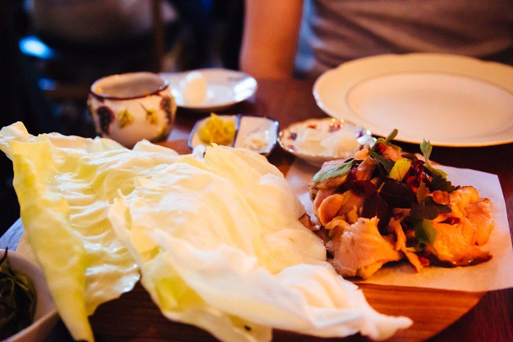 Glazed pork neck, cabbage and condiments