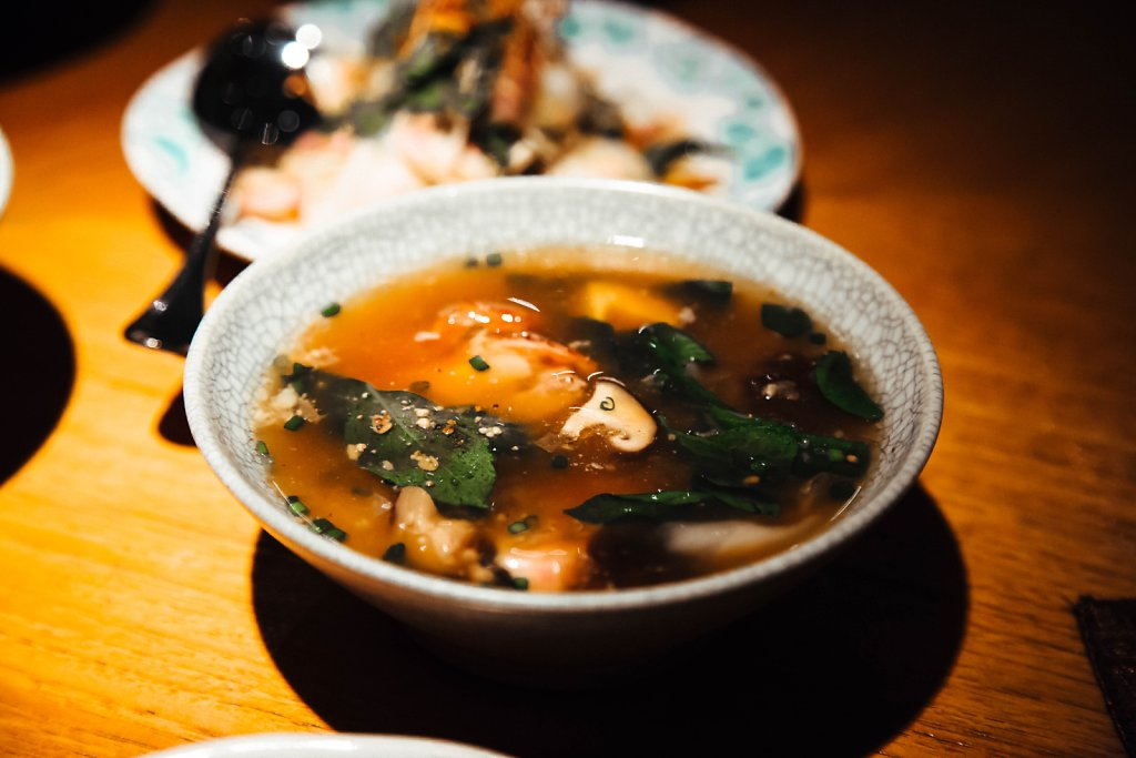 Clear soup of roast duck with thai basil and young coconut